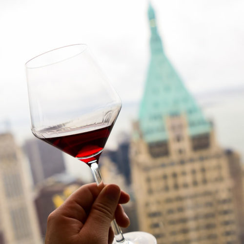 Cheers to the empire state building in NYC with a glass of wine